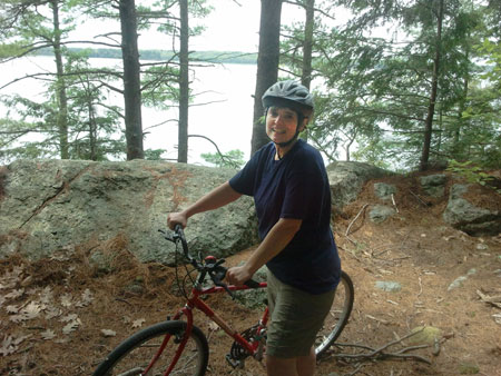Karen Ludwig biking at Butler Head